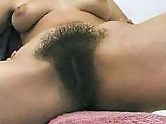 Handsome brunette with big boobs reveals her hairy twat